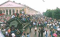 Photo of Cold War demonstrators standing on a Soviet tank, 19 August 1991