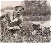 Soldiers working in field