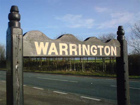 A small town named Warrington. Midway between Liverpool and Manchester, UK