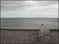 A beach in England with a cloudy sky