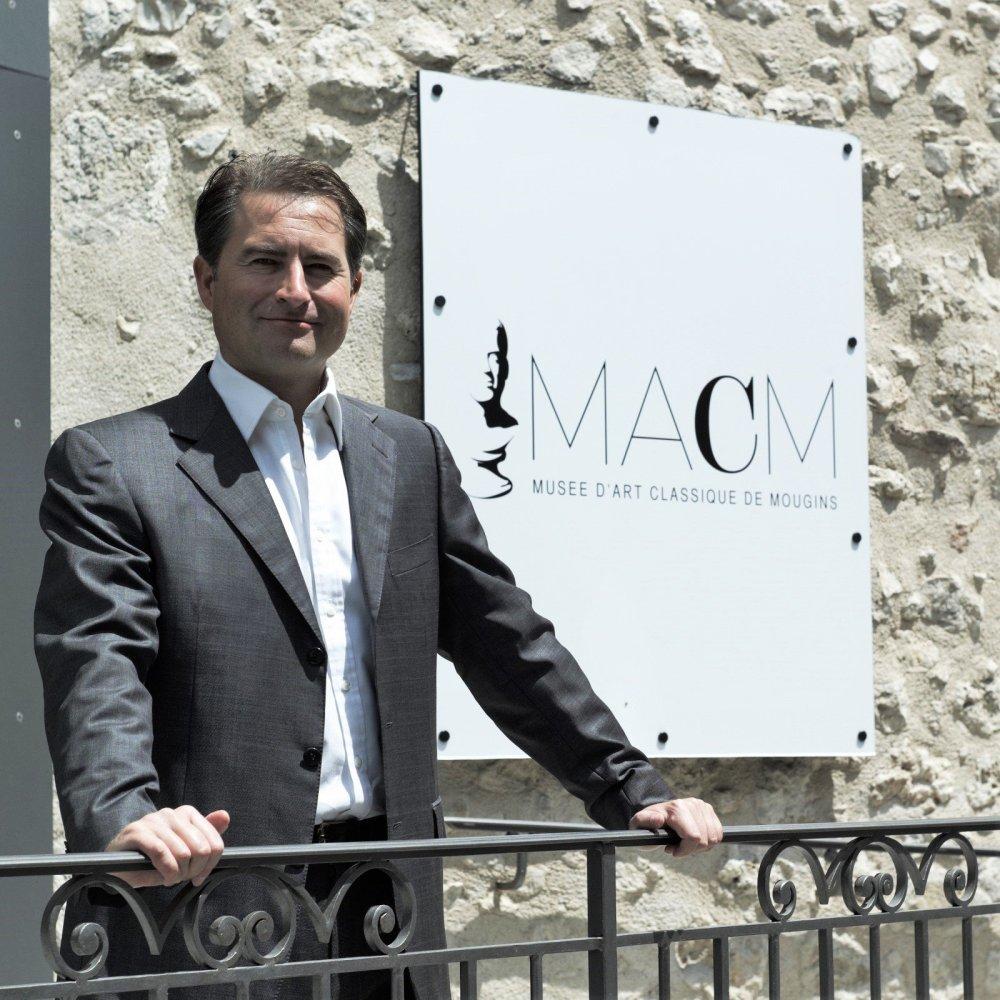 M Christian Levett posing outside his Museum in Mougins France