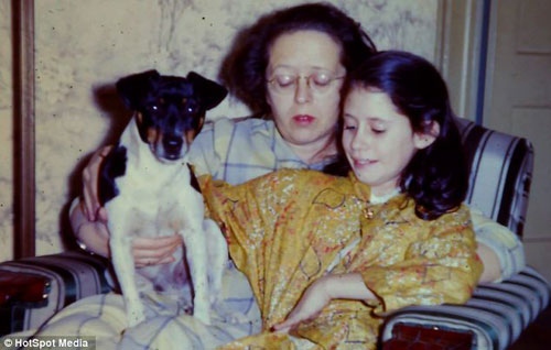 Ms Jacobs (pictured with her mother, Rose, before her skin turned silver) says an air hostess on a plane once tried to give her an oxygen mask when she saw the colour of her face