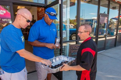 Chef Phillip Dell Passing Out BBQ Samples at the BBQ Concepts Official Grand Opening