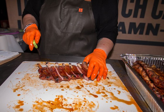 Danielle Bennett showcasing the ribs that was cooked using a Traeger Wood Pellet Grill. Traeger Grills available at BBQ Concepts of Las Vegas, Nevada. #TraegerShopClass #DivaQ #BBQConcepts #LasVegas #Nevada #TeamTraeger #TraegerRibs