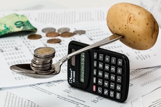 potato and coins balancing on spoon