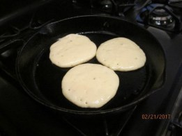 Flip pancakes only once when the bubbles start to pop.