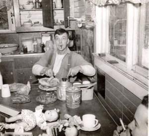 Jack Milligan carves the Easter ham in 1951