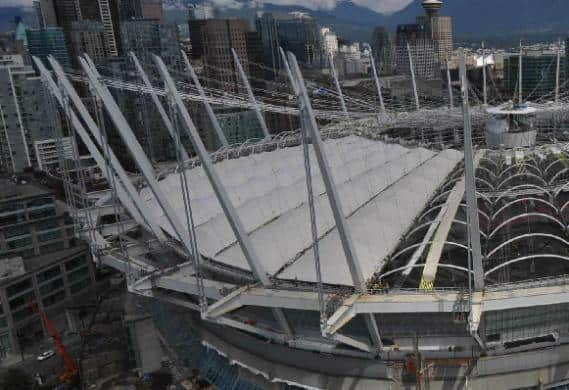 BC Place roof sections being laid in place: Photo capture from BCPlace.com