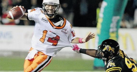 Travis Lulay avoids a Hamilton tackler. - Photo: Canadian Press, Post Media News