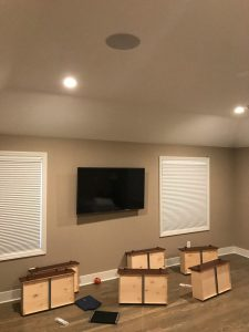 invisible cabling, home theater, additional zones of built-in ceiling speakers, outdoor rock speakers powered by Sonos streaming system, Whitefish Bay, Wisconsin, 1940s brick home with new cabling for home entertainment