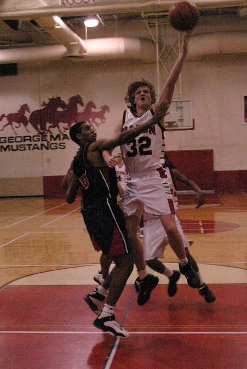 MASON HIGH SOPHOMORE Michael Wolfe drives to the hoop against Madison County. (Photo: Rich Johnson)