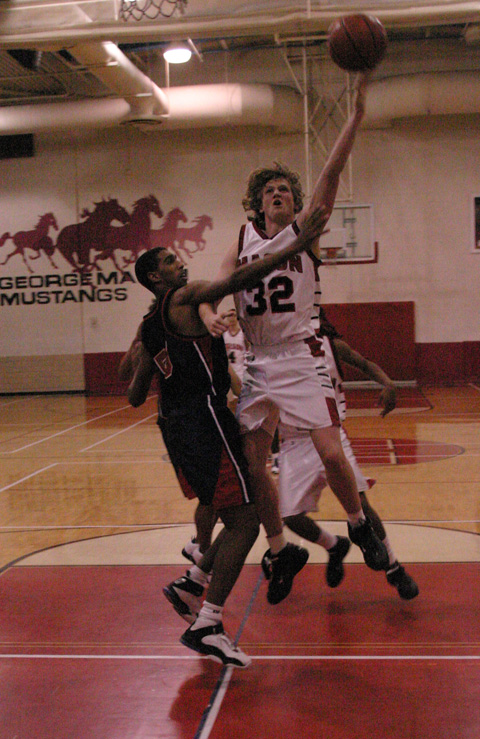 THE MUSTANGS' JOEL CHANDLER (33) takes the ball up in between four defenders and draws the foul in the late fourth quarter Tuesday night. (Photo: Rich Johnson)