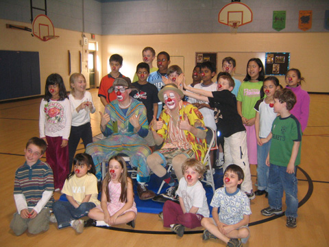 CRICKET, AKA JAMES MCGRATH, (CENTER, RIGHT) appeared in full clown costumery to mingle with some area school children as the Ringling Bros. and Barnum & Bailey Circus continues to make its way through the area.
