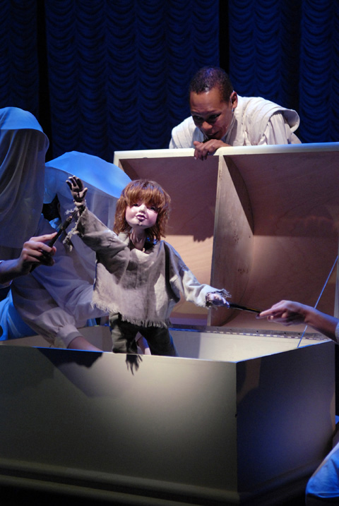 """Peter is brought to life by the Mabou Mines Bunraku puppeteers and The Narrator Karen Kandel (pictured behind chest) in Arena Stage's presentation of """"Peter & Wendy.""""  (Photo courtesy: Arena Stage)"""