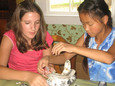 Intriguing scenes abounded at the Blast Into the Past History Camp held at Cherry Hill Farmhouse. Left, Emma Washa and Carrie Gudenkauf piece together Cherry Hill artifacts.