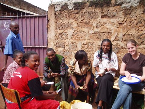 NORTHERN VIRGINIA'S ANNE STOEHR peels potatoes with friends from Nairobi.