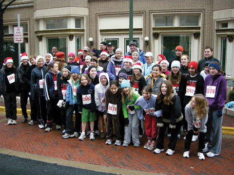 Thirty Five girls from Mary Ellen Henderson Middle School and part of the Girls on Track after school program, led by teachers Kristin White and Rebecca Winner, catch their breath after running in the 5K Reindeer Romp. The girls trained twice a week after school to prepare for the race. (Photo: Courtesy of Cecily Shea)