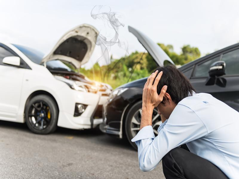 A man is stressed out after being involved in a car accident.