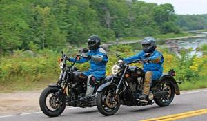 Two motorcycle riders riding abreast