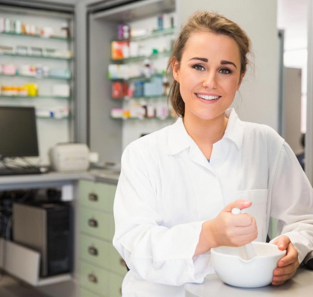 Broward County Pharmacy Association Pharmacist using a pestle and mortar