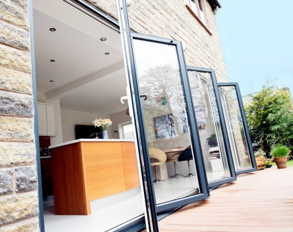 What to look out for when recommending or choosing bi-fold doors? - Trusted manufacturer – It goes without saying, but when sourcing bi-fold doors, look for a reputable manufacturer that design around quality and endurance as well as aesthetics. This is really important, as if the doors are of poor quality you put the property at risk of draughts and rain water entering, quicker wear and tear as well as the possibility of the doors being less secure, if poor quality components are used. - Energy efficiency – Look to the U-value; the lower the better. Bi-folding doors can offer excellent thermal efficiency, helping homeowners to reduce their energy bills. - Weather permeability – Many designs exceed industry set weather standards, offering occupants the peace of mind that the doors will stand up to even stormy weather, and will not be subject to leaks. - Security – The government's building regulations require bi-folding doors to conform to PAS 24 standards in new builds and extensions. Look out for this when selecting bi-fold doors. It's also recommended that even if replacing existing doors, you choose a bi-fold that has passed the PAS 24 testing. Also, take note at the locking system used, and whether there are options to upgrade to ensure maximum security.