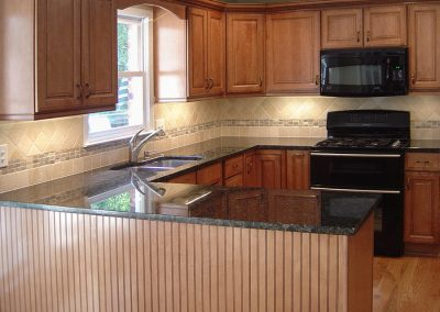 Traditional Kitchen with Maple Cabinets & Black Granite