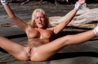 Beautiful Vintage Blonde Tied and Spread on the Beach