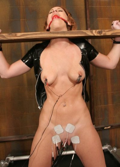 Hot Redhead Model Tortured and Humiliated in Stocks