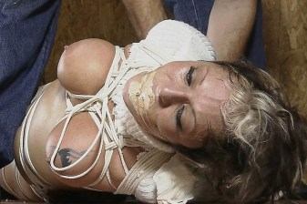Busty Amateur Girl Tightly Hogtied, Blindfolded and Gagged in Basement