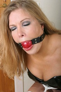 Hot Blond MILF Housewife Chair Tied and Ball Gagged in Black PVC Outfit