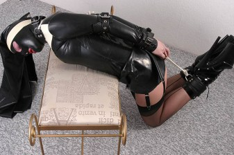Hot Masked Nun in Latex and Garters Collared, Hogtied and Ball Gagged