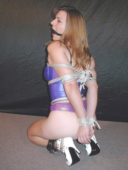 Sexy Young Model Spread, Tied Up and Gagged in High Heels and Corset