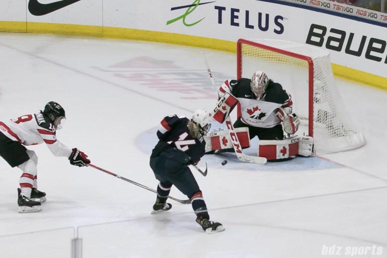 Canada's Shannon Szabados #1 makes a save against USA's Brianna Decker #14's shot