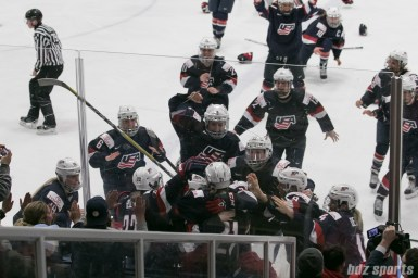 Team USA pile on Hilary Knight #21 after she scores the game-winner, giving team USA its 4th consecutive IIHF Women's World Championships gold medal.