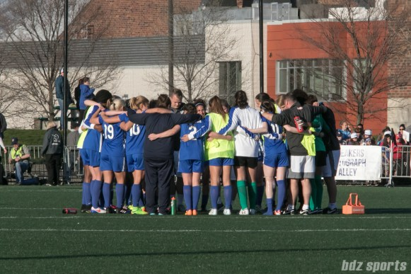 Breakers huddle after the game.