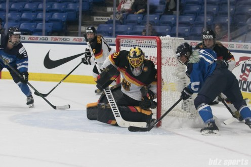 Finland's Linda Valimaki #10 works the puck around the goal to eventually set up Finland's 3rd goal of the game.