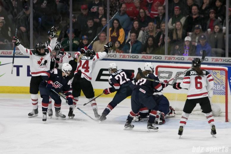 Team Canada celebrates Brianne Jenner #24's game-tying goal.