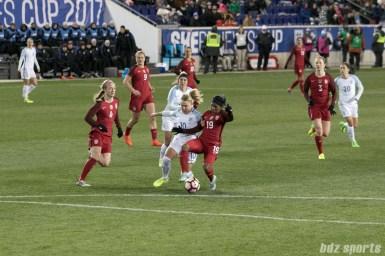 Team USA Crystal Dunn shields off a defender