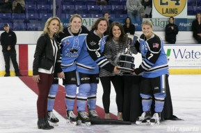 Beauts captains Kelley Steadman, Megan Boze, and Emily Pfalzer accept the Isobel Cup