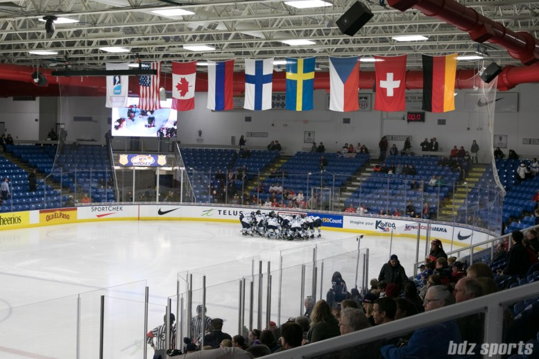 Team Finland huddles before the start of the game