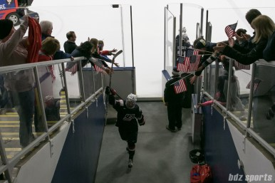 USA's Kalli Flanagan #6 stick-fives fans after exiting the ice.