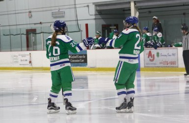 Connecticut whale players Cydney Roesler and Jordan Brickner fist bump