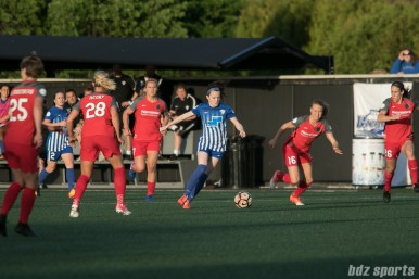 Boston Breakers midfielder Rose Lavelle (11) dribbles through Portland Thorns FC players.
