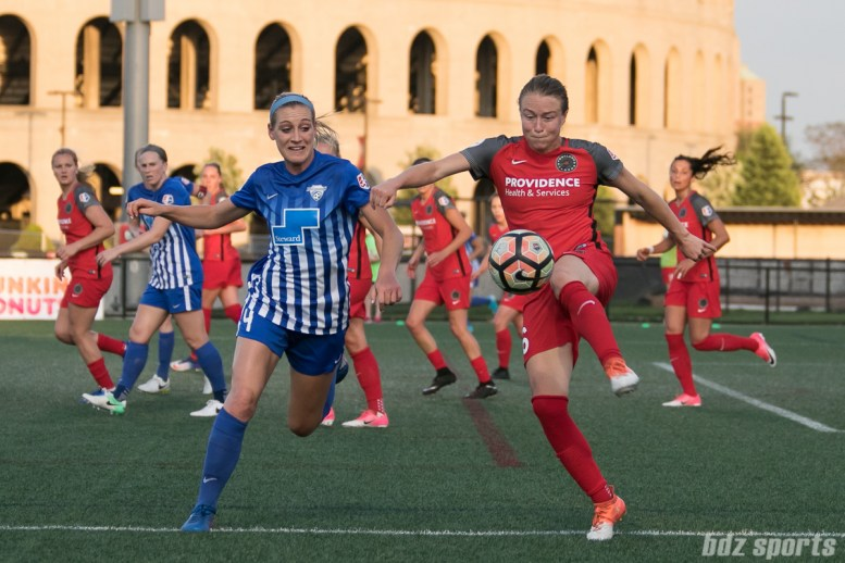 Portland Thorns FC defender Emily Sonnett (16) looks to clear the ball out of danger while being pressured by Boston Breakers defender Megan Oyster (4).