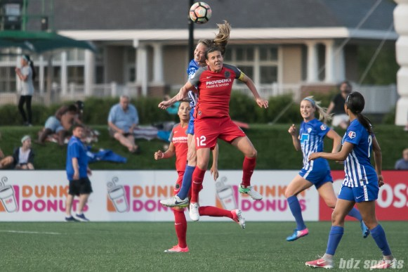 Portland Thorns FC forward Christine Sinclair (12) and Boston Breakers defender Julie King (8) battle in the air for the ball.