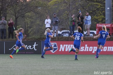 Breakers' Adriana Leon #19 shows her Breakers patch as she celebrates her goal with the fans.