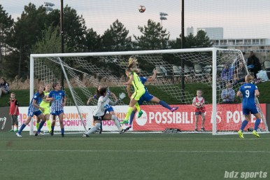 Reign FC's Beverly Yanez #17 heads the ball over the crossbar.