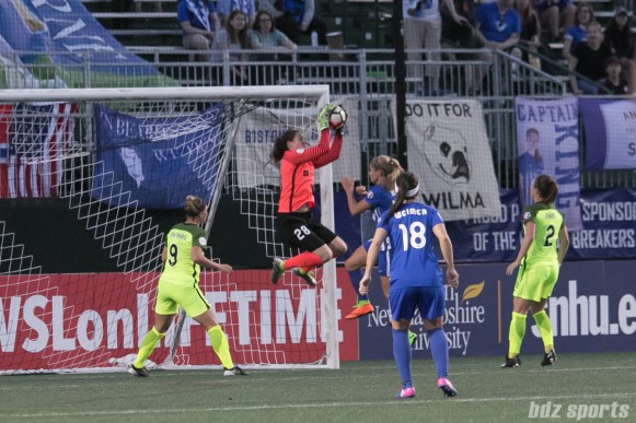 Reign FC's Haley Kopmeyer #28 grabs the ball out of the air.