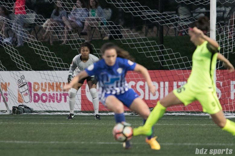 Breakers' Abby Smith #14 looks on while Breakers' Allysha Chapman #2 and Reign FC's Nahomi Kawasumi #36 battle for control.