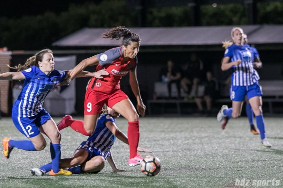 Portland Thorns FC forward Nadia Nadim (9) holds off Boston Breakers defender Allysha Chapman (2) as she dribbles towards the goal.